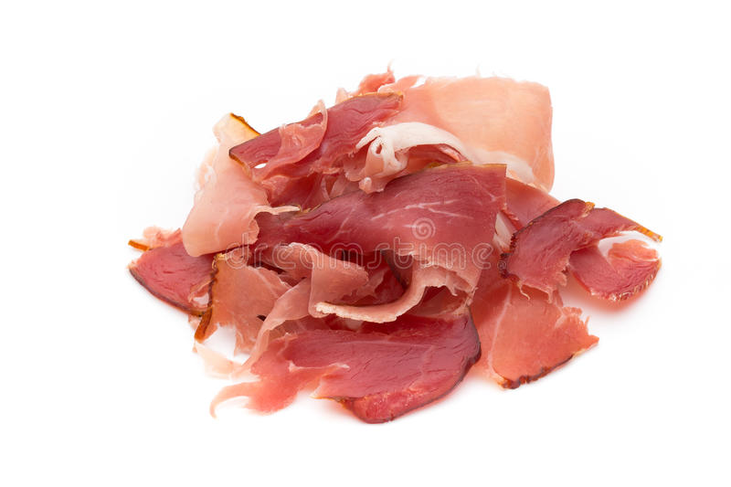 Slices of ham on white background. Jamon of ham on white background stock images