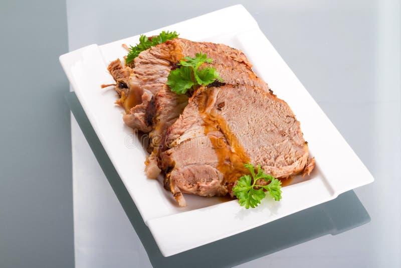 Slices of homemade roast pork royalty free stock image