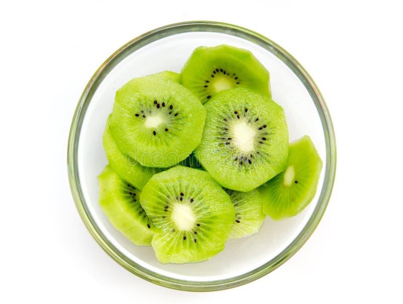 Slices of kiwi fruit bowl on top royalty free stock photos