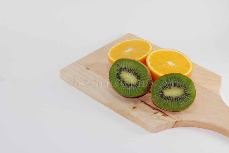 Slices of kiwi and orange on a plate. Picture of slices kiwi and orange on a plate on white background stock images
