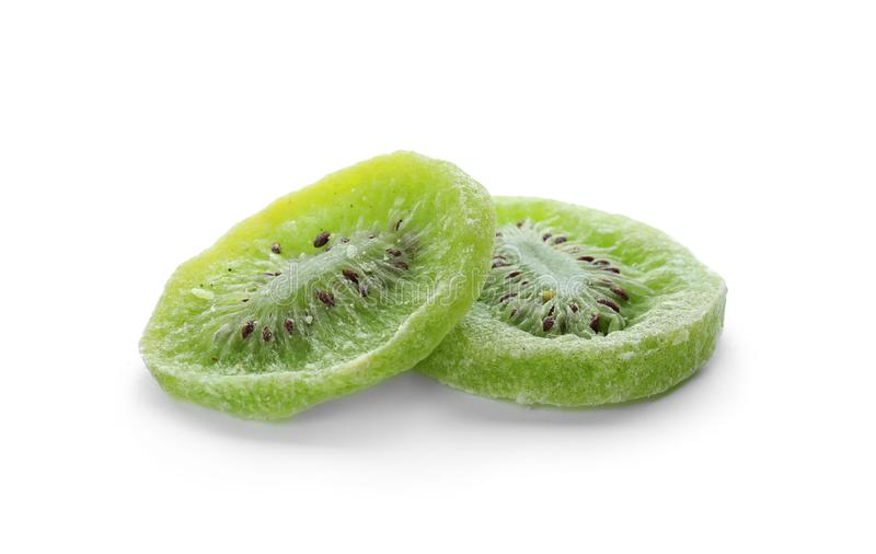 Slices of kiwi on white background. Dried fruit stock image