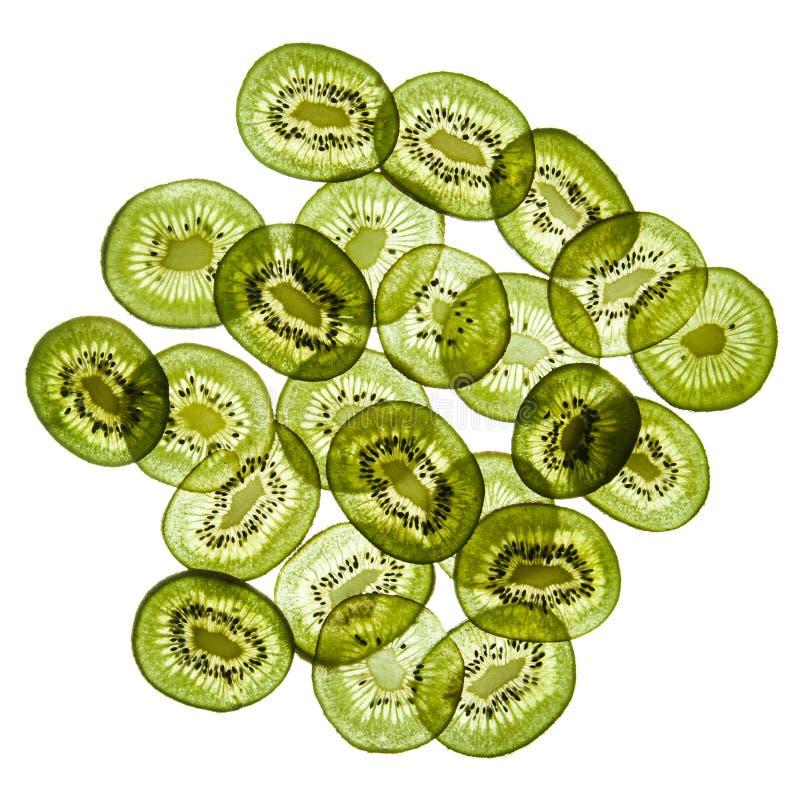 Slices of kiwi on the white. Transparent fresh slices of kiwi isolated on white background stock image
