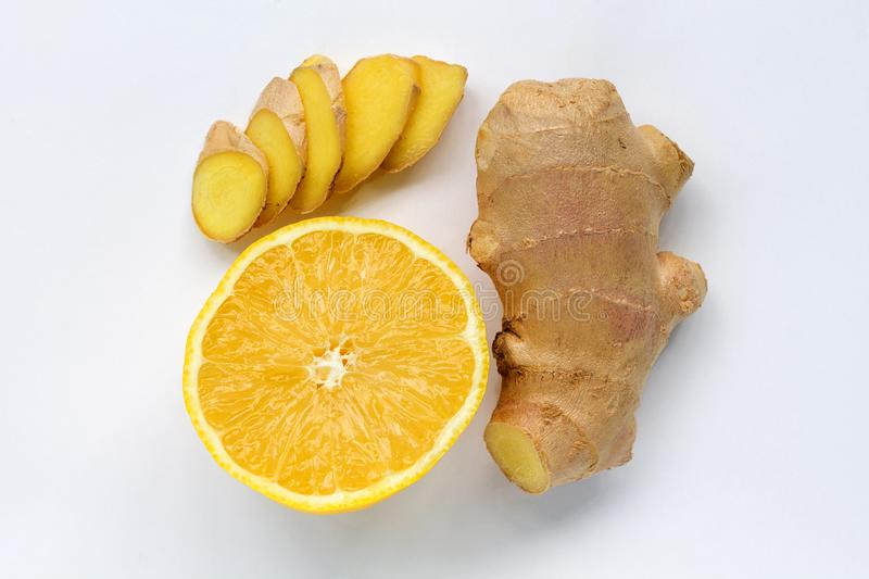 Slices of lemon and fresh ginger isolated on white background top view stock images
