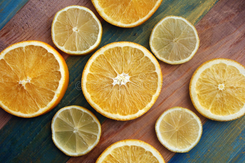 Slices of lemon and orange. On a wooden table royalty free stock photos