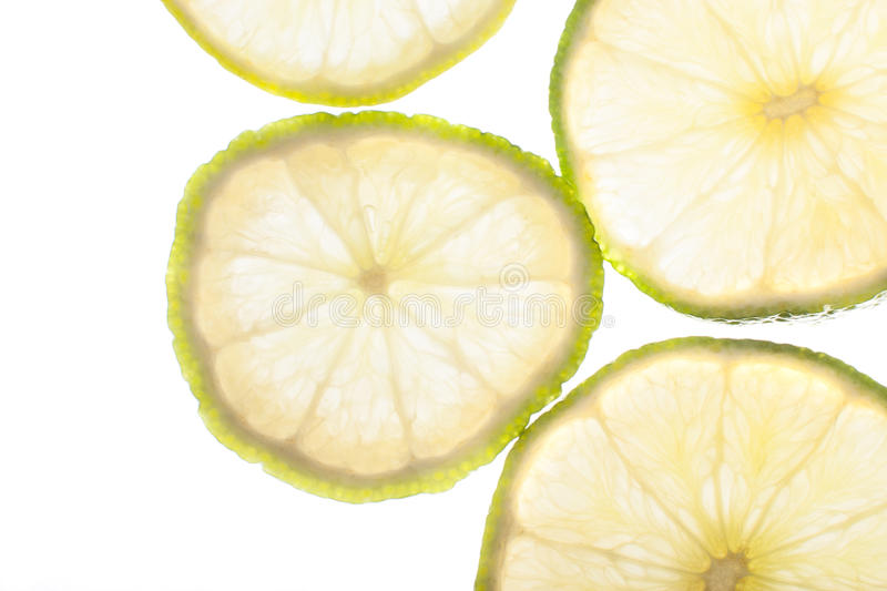 Slices of lime. Fresh lime slices on white stock image