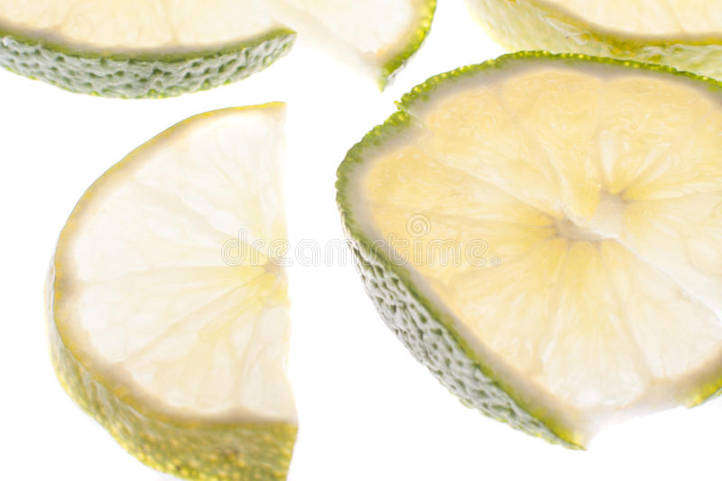 Slices of lime. Fresh lime slices on white royalty free stock image