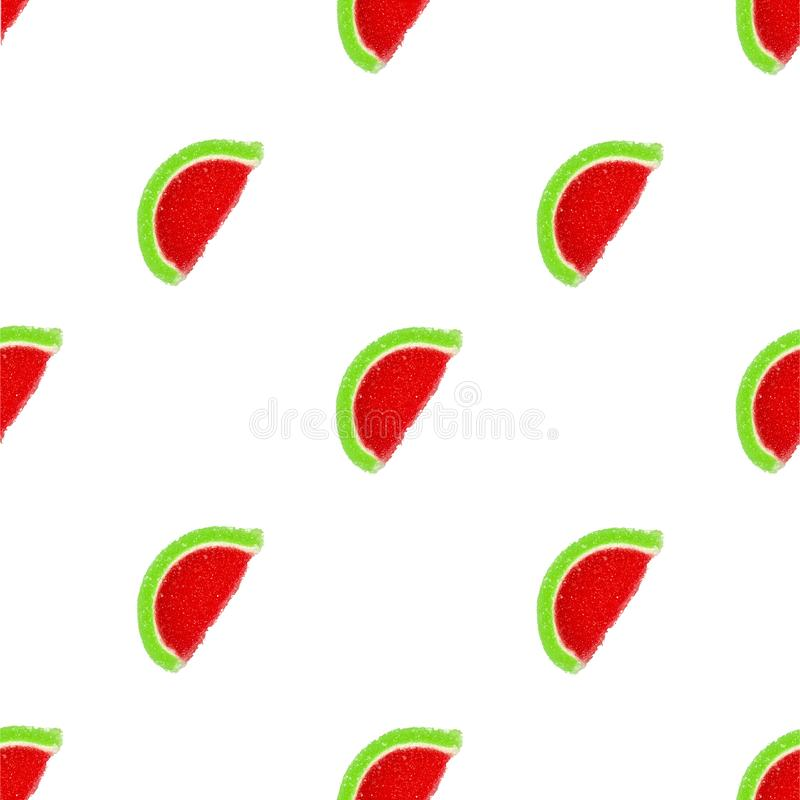 Slices of marmalade in the shape of a watermelon isolated on a white background. Seamless background stock photos