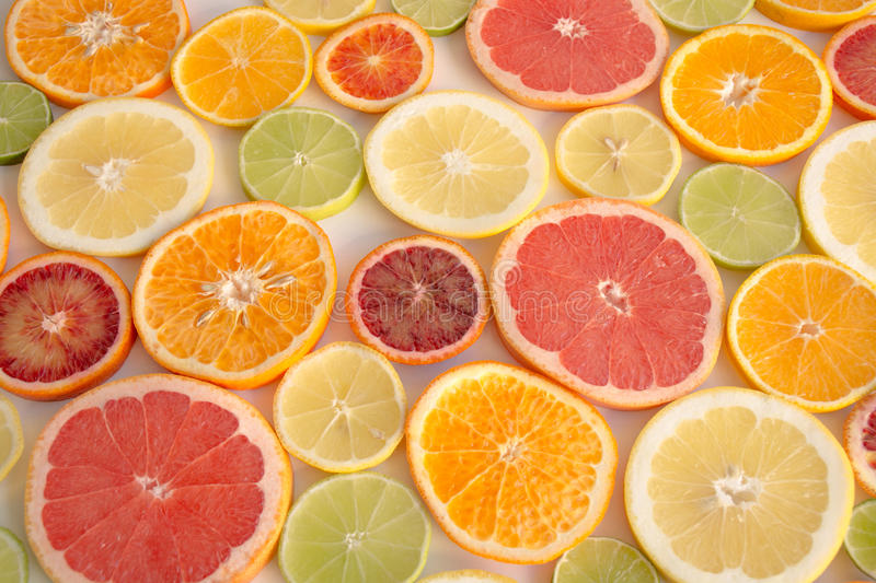 Slices of orange, grapefruit, blood orange lemon, lime stock images