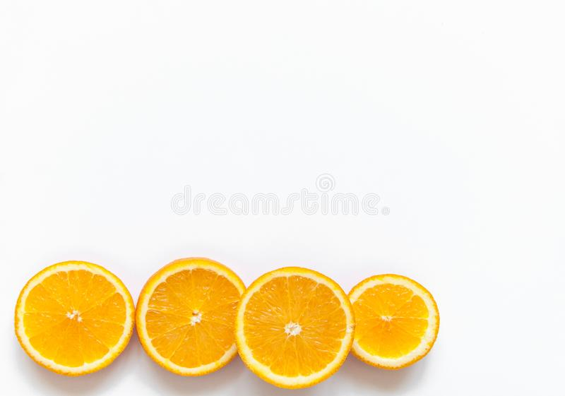 Slices of orange on a white background. Fruit with vitamins. Tablets with vitamin C against colds. Exotic tropical fruit for juice. Orange food. Meals for stock photo