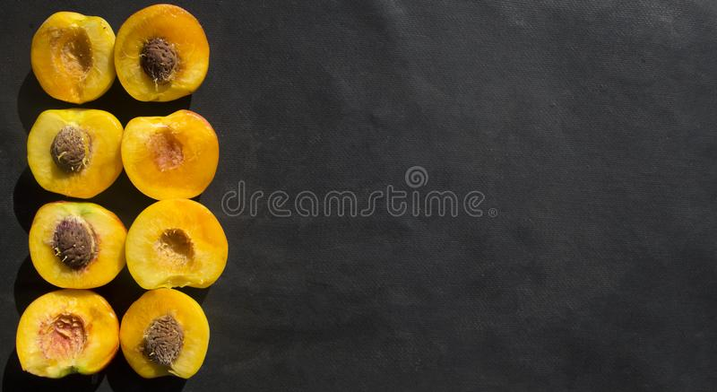 Slices of peaches on marble stock photo