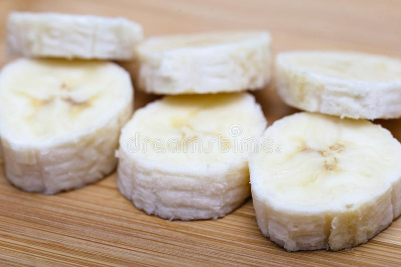 Sliced banana fruit in small pieces. Slices and pieces of banana, healthy fruit and excellent for dieting or making vitamins stock photography