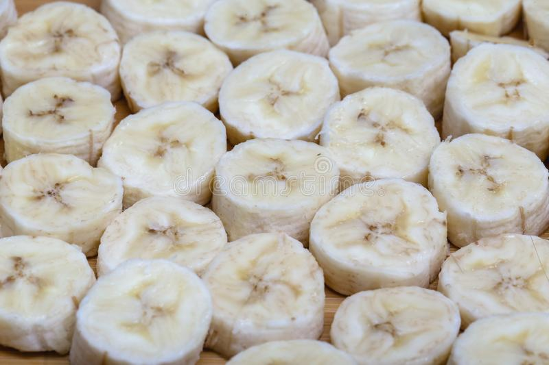 Sliced banana fruit in small pieces. Slices and pieces of banana, healthy fruit and excellent for dieting or making vitamins stock photo