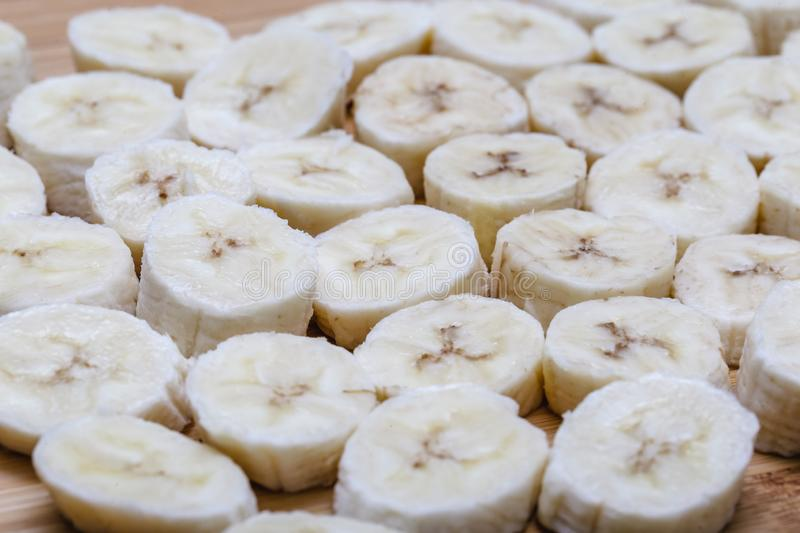 Sliced banana fruit in small pieces. Slices and pieces of banana, healthy fruit and excellent for dieting or making vitamins royalty free stock image