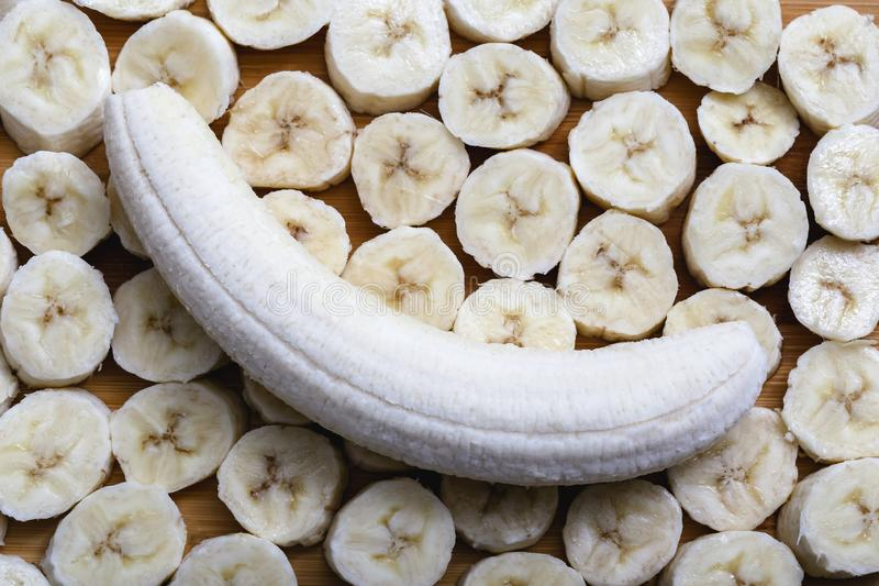 Sliced banana fruit in small pieces. Slices and pieces of banana, healthy fruit and excellent for dieting or making vitamins royalty free stock photography