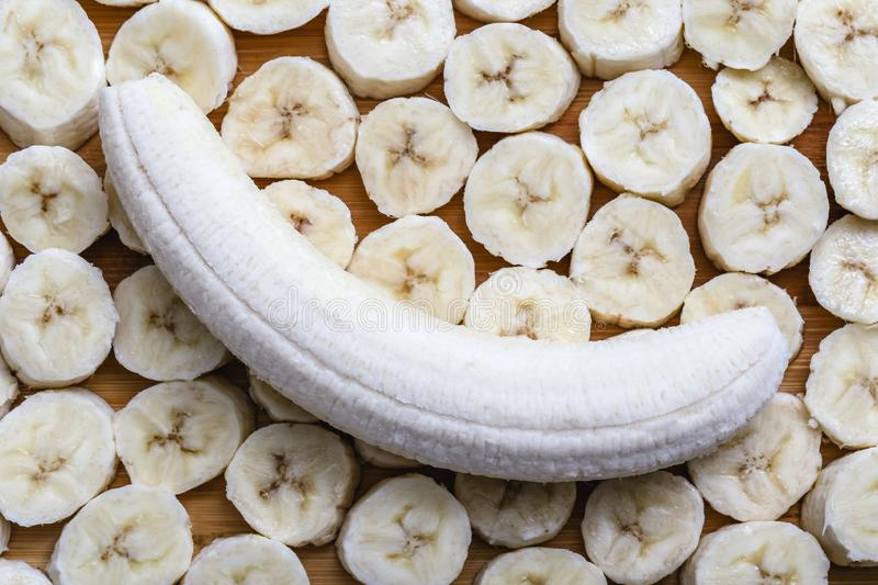 Sliced banana fruit in small pieces. Slices and pieces of banana, healthy fruit and excellent for dieting or making vitamins royalty free stock photos
