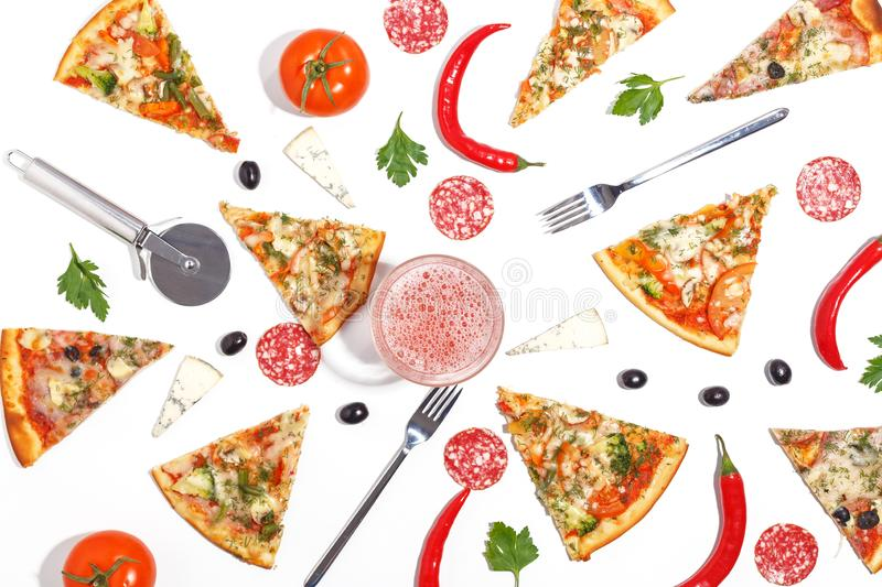 Slices of pizza, ingredients and cutlery on a white background. Top view. Olive cheese basil italian ketchup wooden food dinner tomato sliced isolated margarita royalty free stock images
