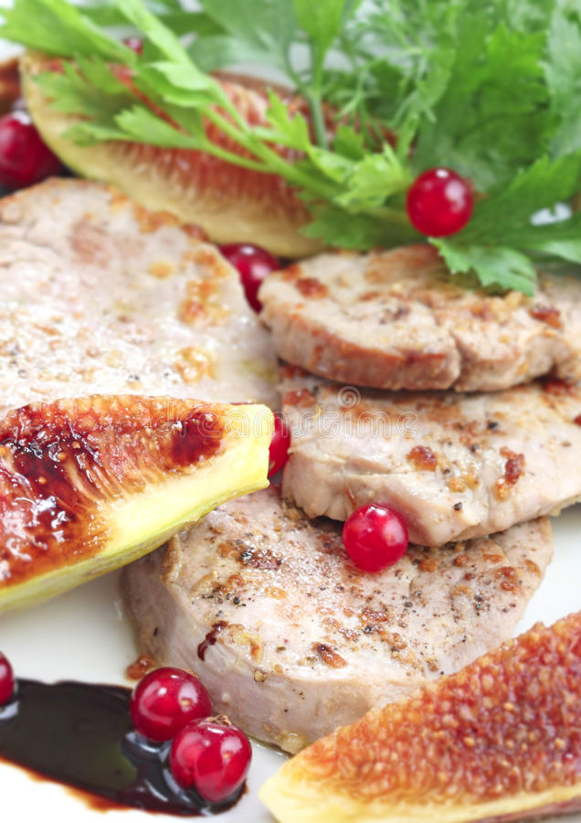 Slices of pork with figs and berry fruit