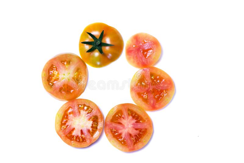 Slices of red tomatoes laid out in a circle. Top View. Close up of freshness and health concept royalty free stock images