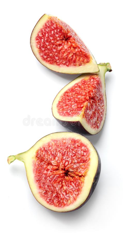 Slices of ripe figs isolated on a white background. Good texture and vibrant saturated colors. Top view royalty free stock images