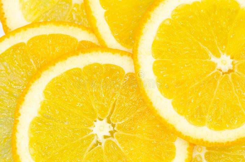 Slices of ripe orange close-up, the texture of an exotic fruit royalty free stock image