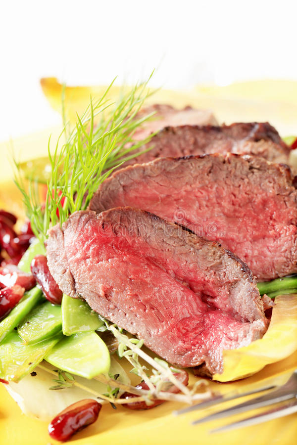 Roast beef with vegetable garnish royalty free stock image
