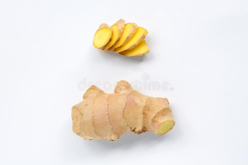 Slices and root of ginger isolated on white background top view royalty free stock photo