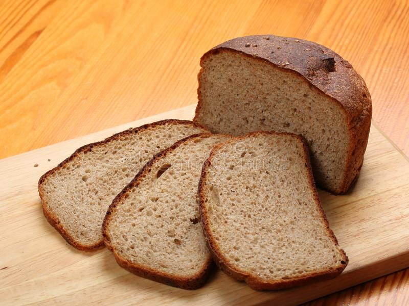 Slices of rye bread on a wooden board royalty free stock photography