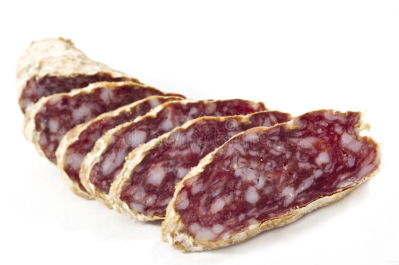 Slices of salame from Italy. On white background stock photos