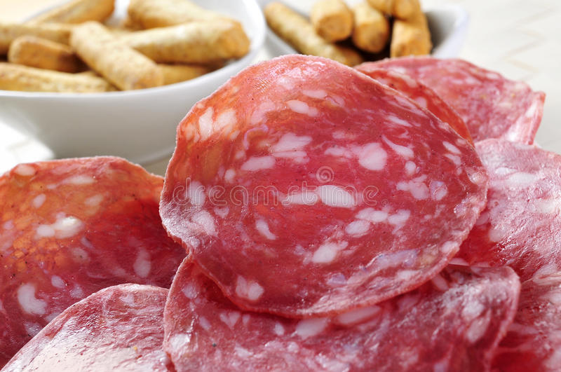 Slices of salchichon, spanish cured sausage royalty free stock photos
