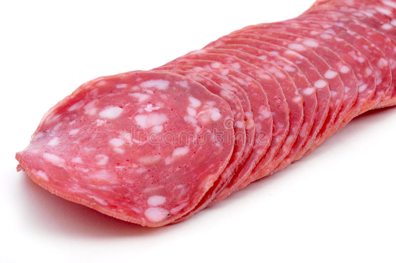 Slices of salchichon, spanish cured sausage stock photo