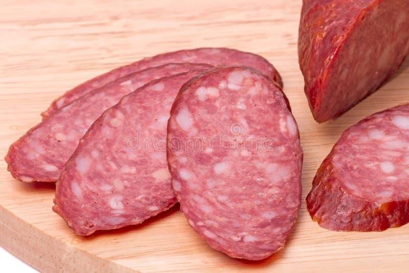 Slices of smoked sausage close up stock photo