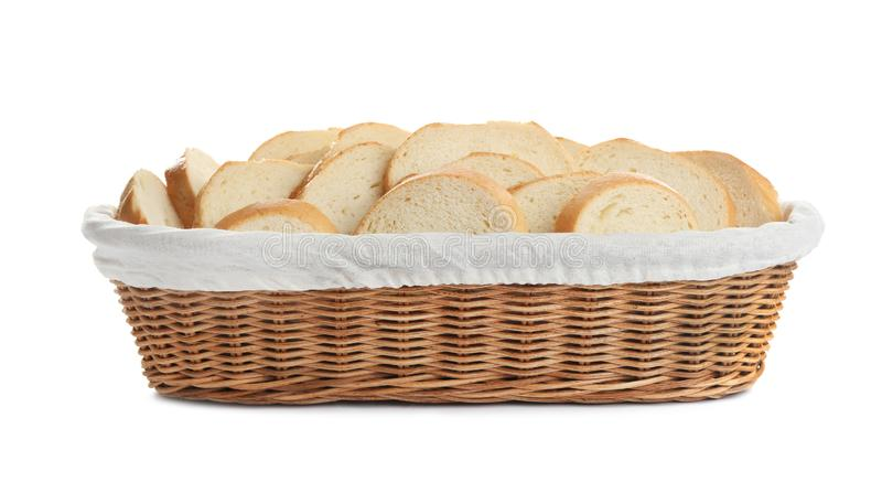 Slices of tasty fresh bread in wicker basket on white background stock images