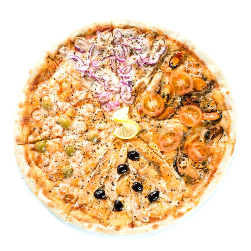 Slices of traditional Italian delicious pizza with different top stock photography