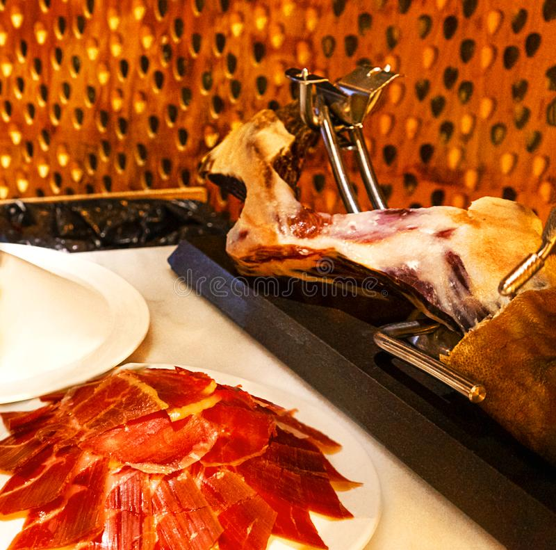 Slices of traditionally Spanish jamon de bellota in the restaurant or market or store. royalty free stock photography