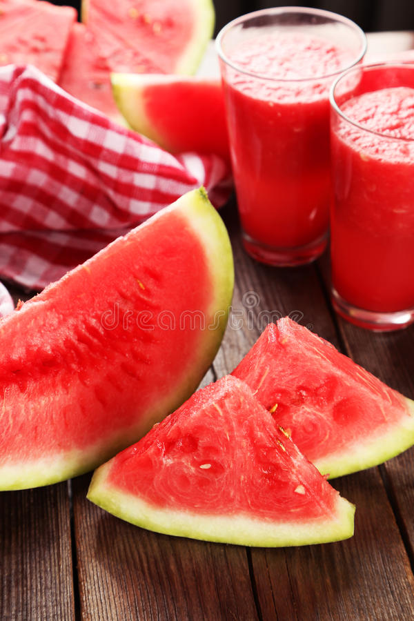 Slices of watermelon on brown wooden background stock image