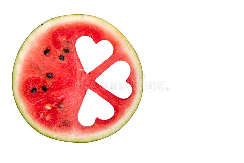 Slices of watermelon in the heart shape on vintage wooden table. royalty free stock photography