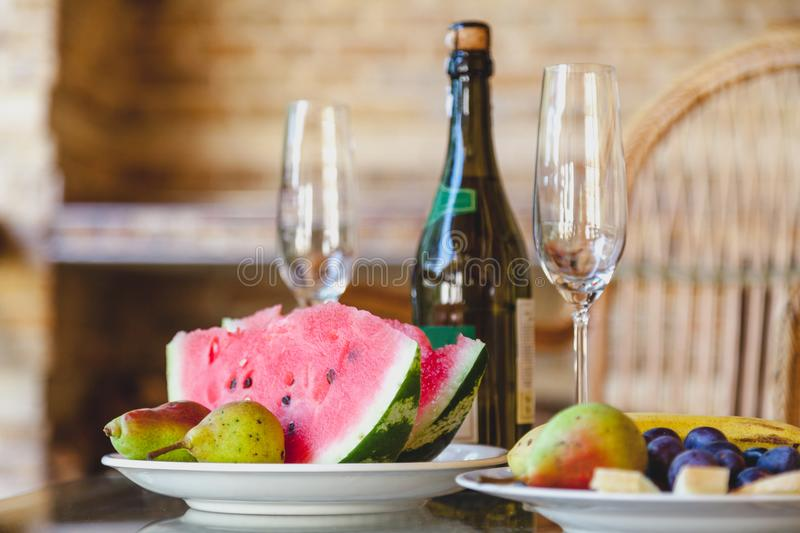 Slices of watermelon and pears lie on plate royalty free stock photo