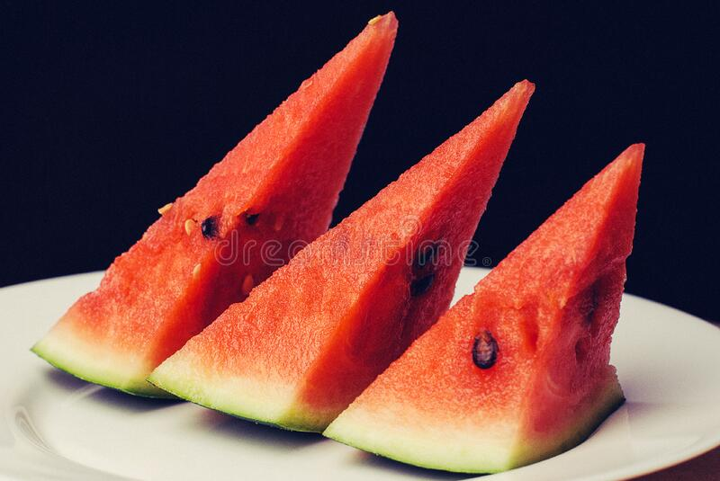 Slices of watermelon on plate stock photo