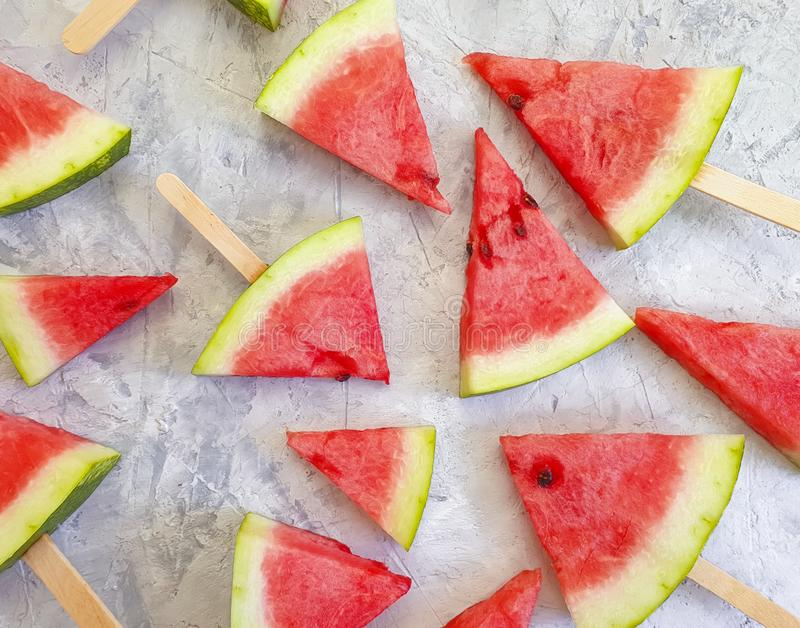 Slices of watermelon summer healthy food a gray concrete background creative stock image