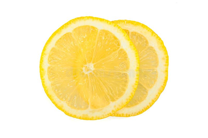 Slices of yellow lemon stock image