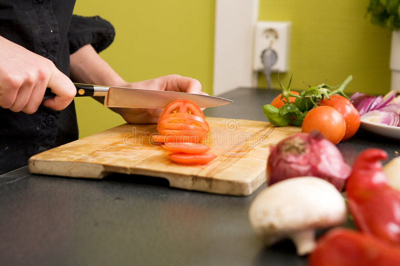 Slicing Tomatoes Detail royalty free stock images