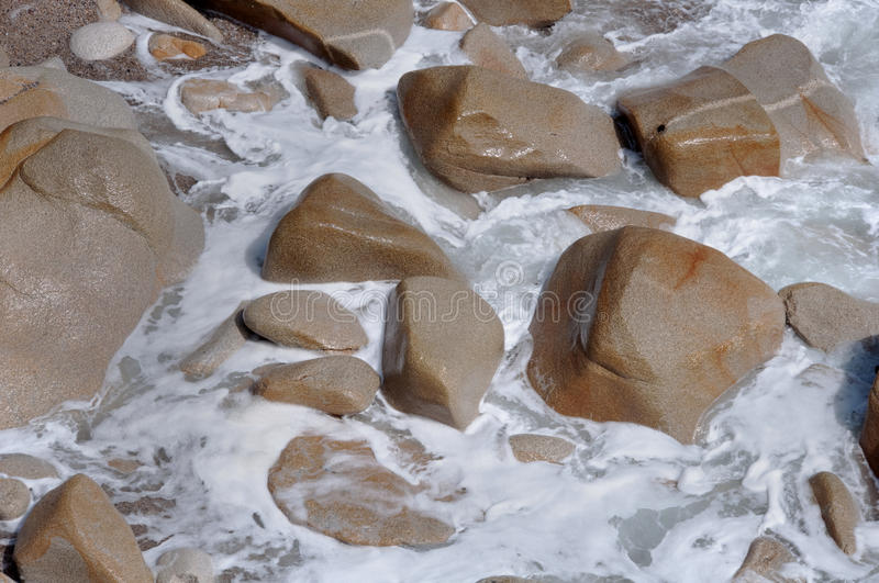 Slick Rocks, Frothy Shore Royalty Free Stock Images