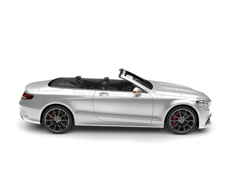 Slick silver modern luxury convertible car - side view royalty free stock photography