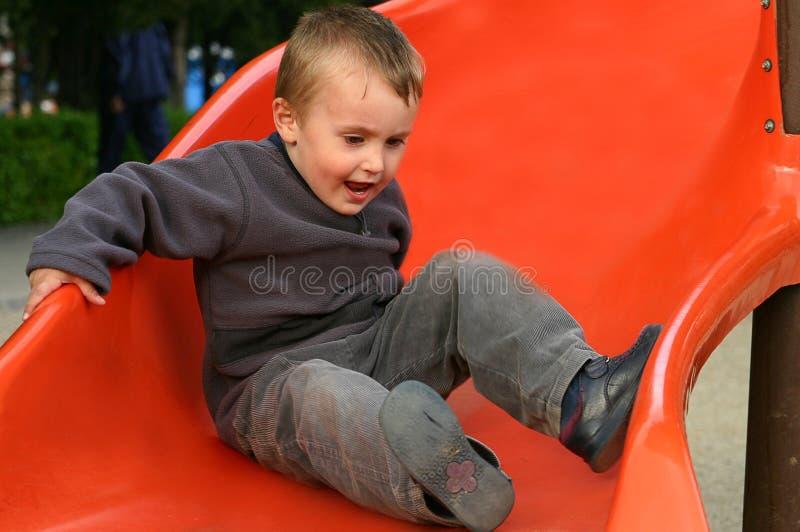Slidding children stock photography