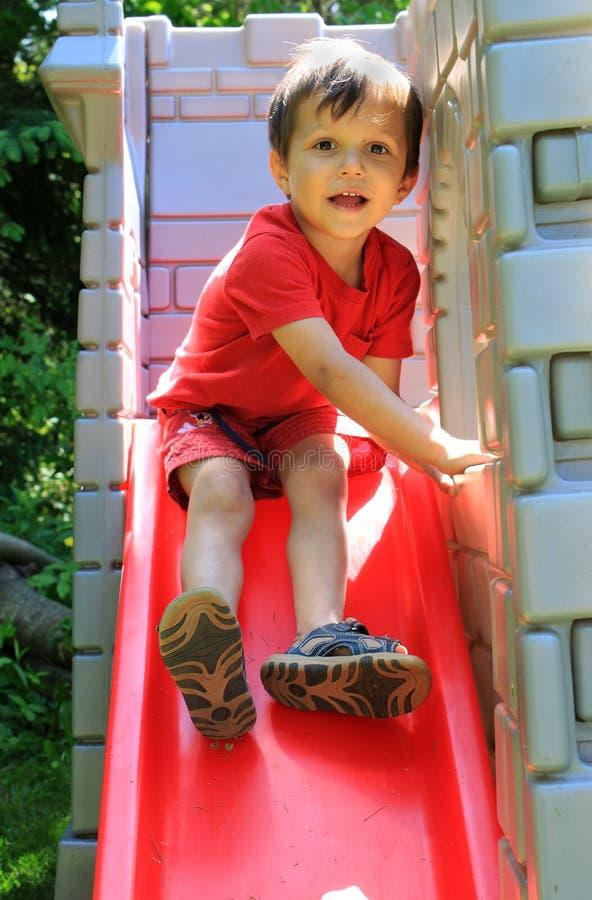 Slide boy stock photo