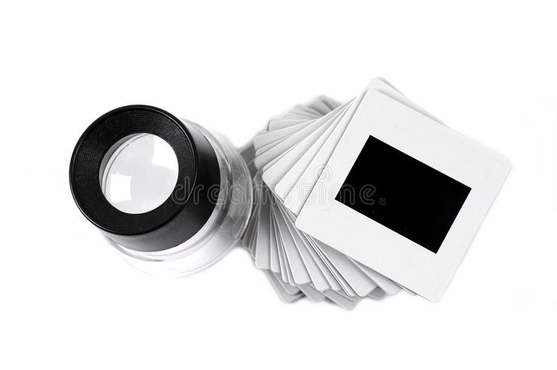 Slide and loupe royalty free stock image