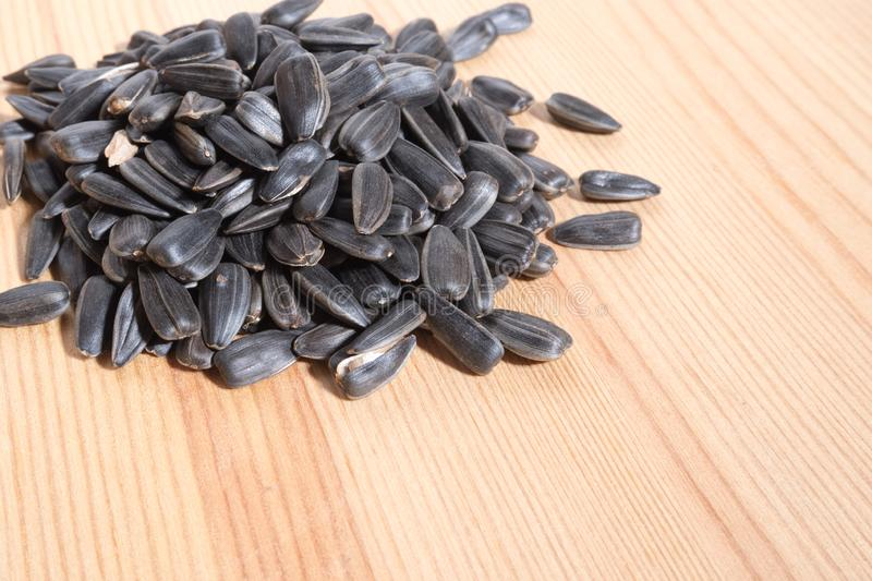 A slide of roasted seeds on a wooden background. Horizontal photo format stock photography