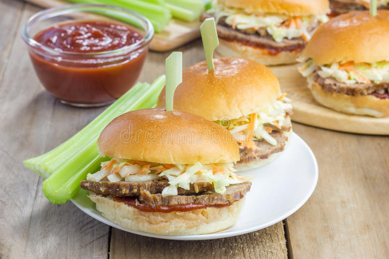 Sliders with beef brisket, barbecue sauce and coleslaw. Closeup royalty free stock photos