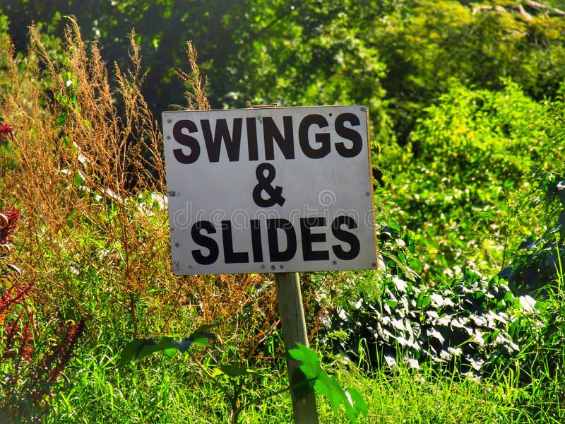 Slides and swings stock images