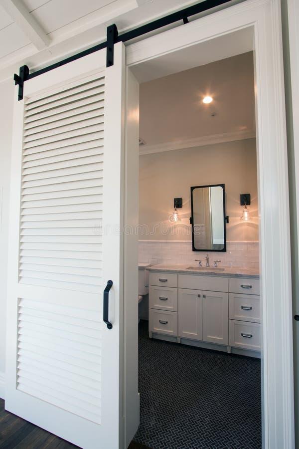 Interior Sliding Barn Doors Into Bathroom Stock Image